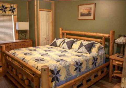 bed in a room in the cabin